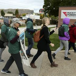 Rocky Mountain Power customers deliver a petition with 4,000 signatures demanding strong and clear action plans to transition away from coal at the company's headquarters in Salt Lake City on Wednesday, Oct. 9, 2019.