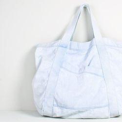 "<b>Oak</b> denim tote bag, $92 at <a href=""http://www.oaknyc.com/denim-tote-bag-medium-21746.html?enlarged"">Oak</a>."