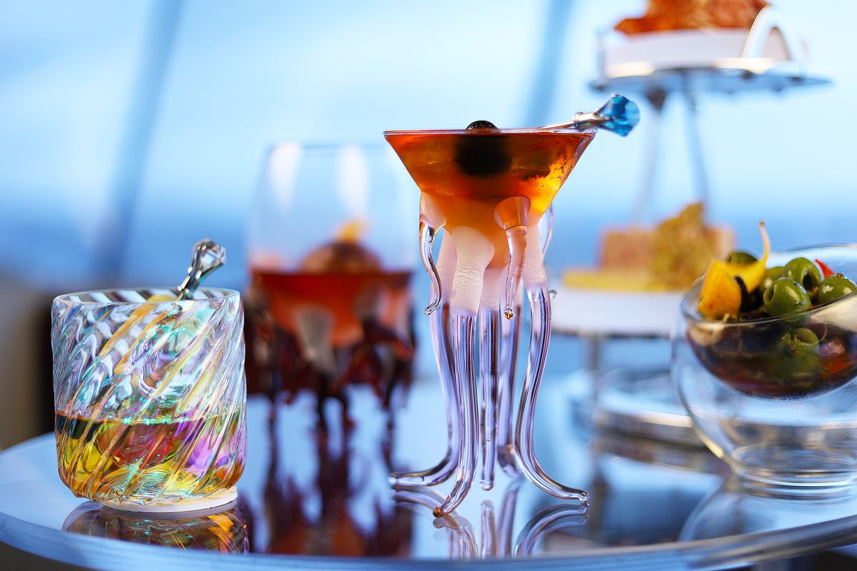 From the lounge at the top of the Space Needle, a view of several cocktails, including one served in a glass that evokes a tentacled sea creature