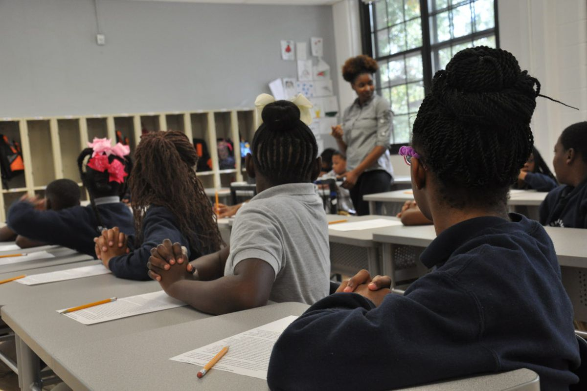 Angelique Hines gets her students' attention during a lesson.