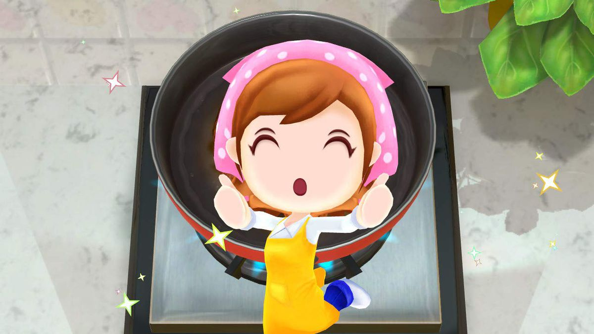 Cooking Mama celebrates in front of a pot
