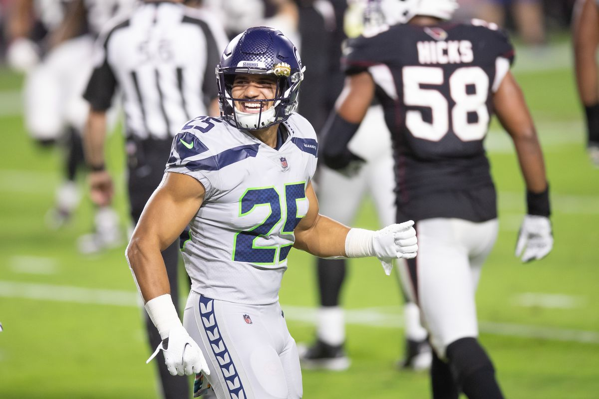 Seattle Seahawks running back Travis Homer (25) reacts against the Arizona Cardinals in the second quarter at State Farm Stadium.