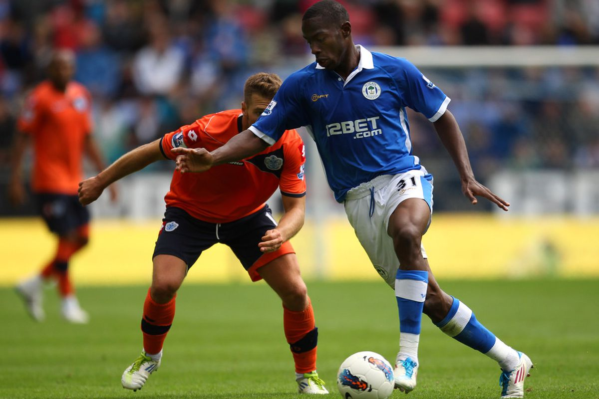 Maynor Figueroa of Wigan Athletic shields the ball from Akos Buzsaky of Queens Park Rangers during the Barclays Premier League match between Wigan Athletic and Queens Park Rangers at the DW Stadium.