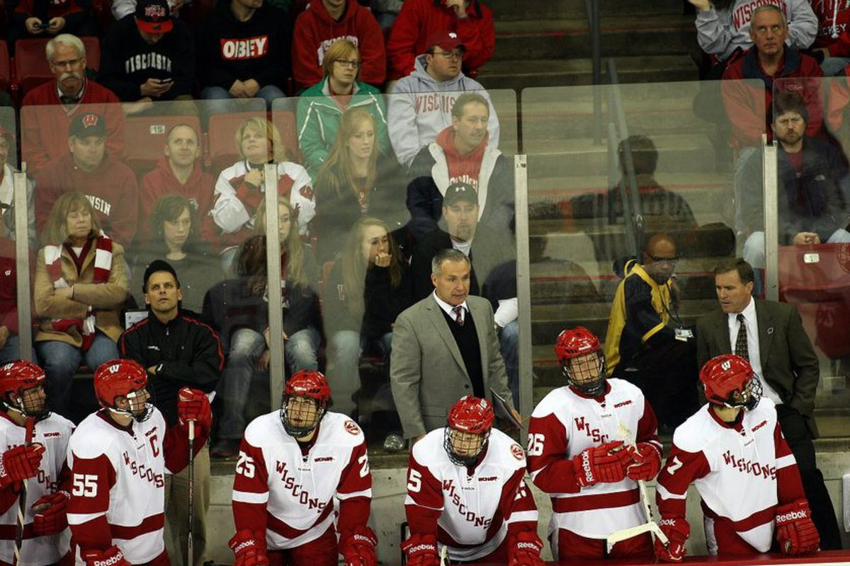 Assistant coach Bill Butters (back row, middle, in gray suit) resigned on Wednesday, adding to Wisconsin's early-season turmoil.