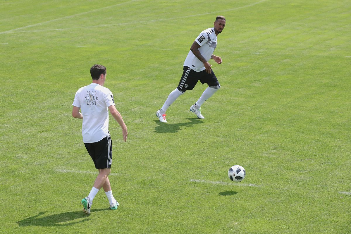 Germany - Southern Tyrol Training Camp Day 9 EPPAN, ITALY - MAY 31: Jerome Boateng and team mate Sebastian Rudy (L) run with the ball during a training session of the German national team at Sportanlage Rungg on day nine of the Southern Tyrol Training Camp on May 31, 2018 in Eppan, Italy.