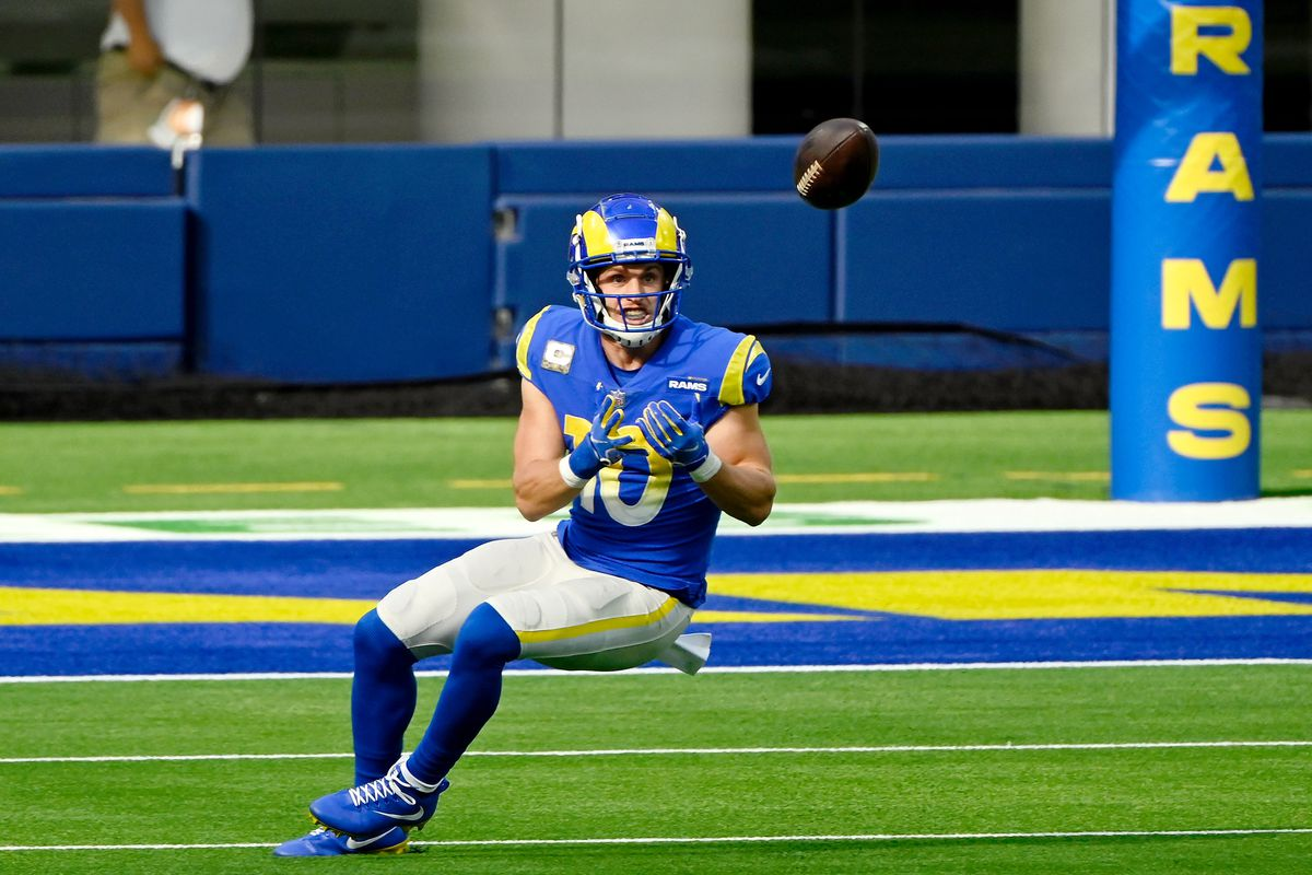 Los Angeles Rams wide receiver Cooper Kupp (10) makes a catch against the Seattle Seahawks during the first half at SoFi Stadium.
