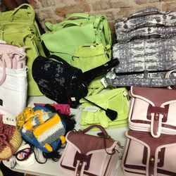 Opening Ceremony and Kenzo bags. The small pink and green bags are $110, the larger green bags are $155.