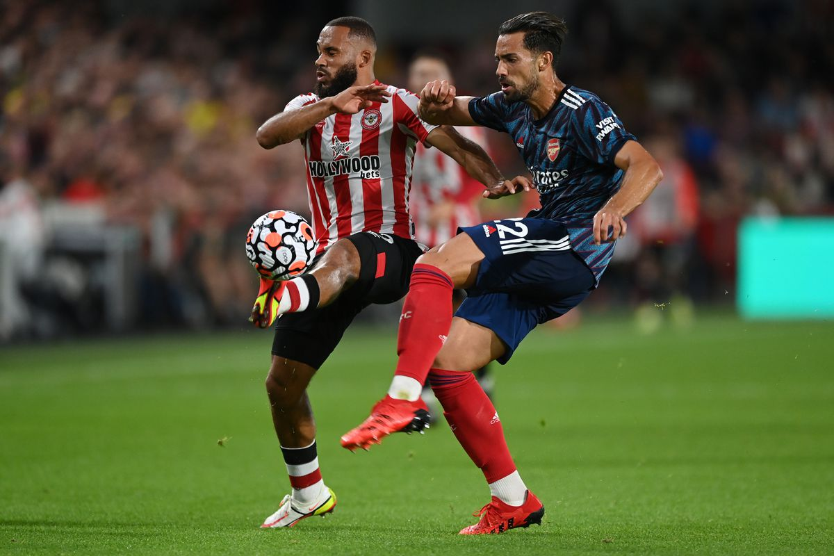 Bryan Mbeumo of Brentford and Pablo Mari of Arsenal battle for the ball during the Premier League match between Brentford and Arsenal at Brentford Community Stadium on August 13, 2021 in Brentford, England.