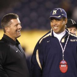 Utah coach Kyle Whittingham and Navy coach Ken Niumatalolo talk before their game as the University of Utah plays Navy in the Poinsettia Bowl in San Diego on Dec. 20, 2007.