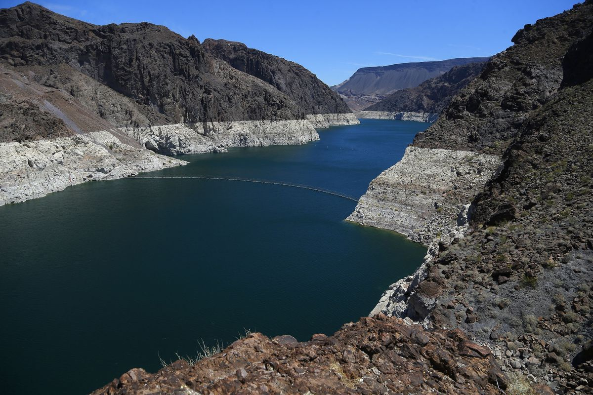 FILE - In this May 31, 2018, file photo, the low level of the water line is shown on the banks of the Colorado River in Hoover Dam, Ariz. Seven Southwestern U.S. states that depend on the overtaxed Colorado River say they have reached tentative agreements