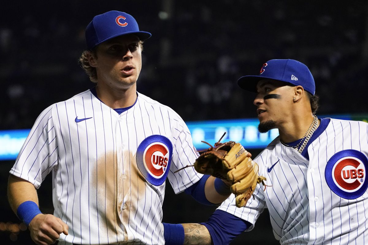 The Cubs' Nico Hoerner, left, and Javy Baez have displayed solid defense in the middle of the infield.