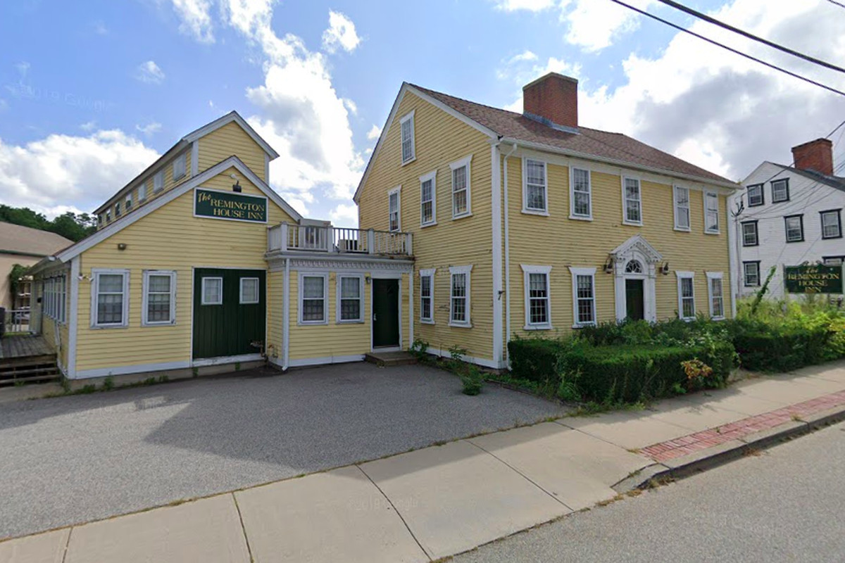 Exterior of a restaurant that looks like an old house. It's pale yellow and appears to be located on a main street.