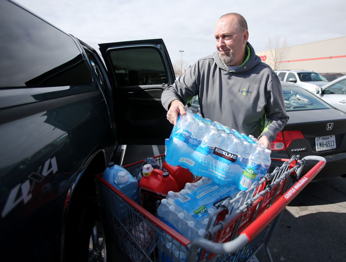 Rich Rice loads some bottled water into his truck as he and other shoppers at the Lehi Walmart purchase water bottles, toilet tissue and other items in the wake of coronavirus concerns on Tuesday, March 3, 2020. Shoppers are being told that they can only buy up to five cases of water and up to three cases of toilet tissue from that store.