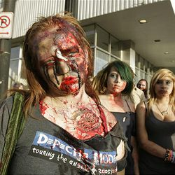 Zombie Walk participant Rose Bench strolls the streets of Salt Lake City on Sunday.
