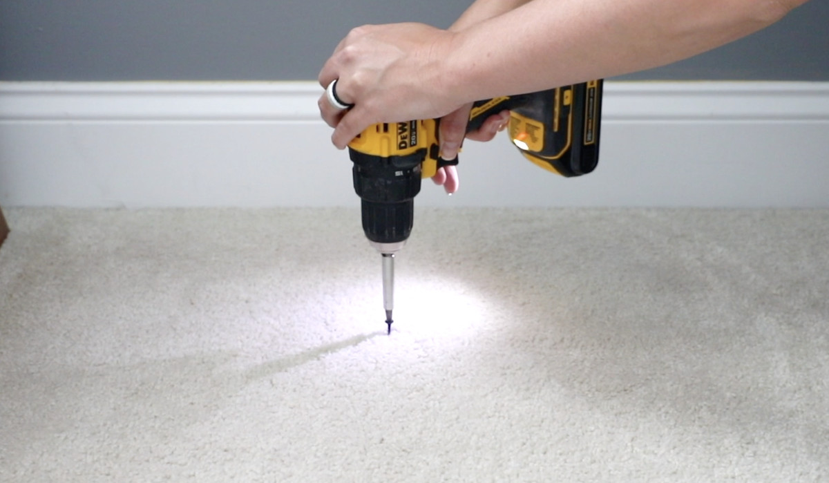 Drilling a drywall screw into floor to silence a squeak