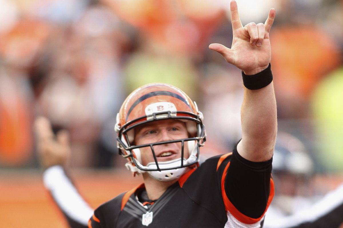 Andy Dalton thows up sign language after hearing that Alpha is in the stands.