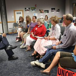 Martell Menlove, Utah Superintendent of Public Instruction, speaks with Common Core opponents at the State Board of Education office in Salt Lake City on Friday, Aug. 2, 2013.