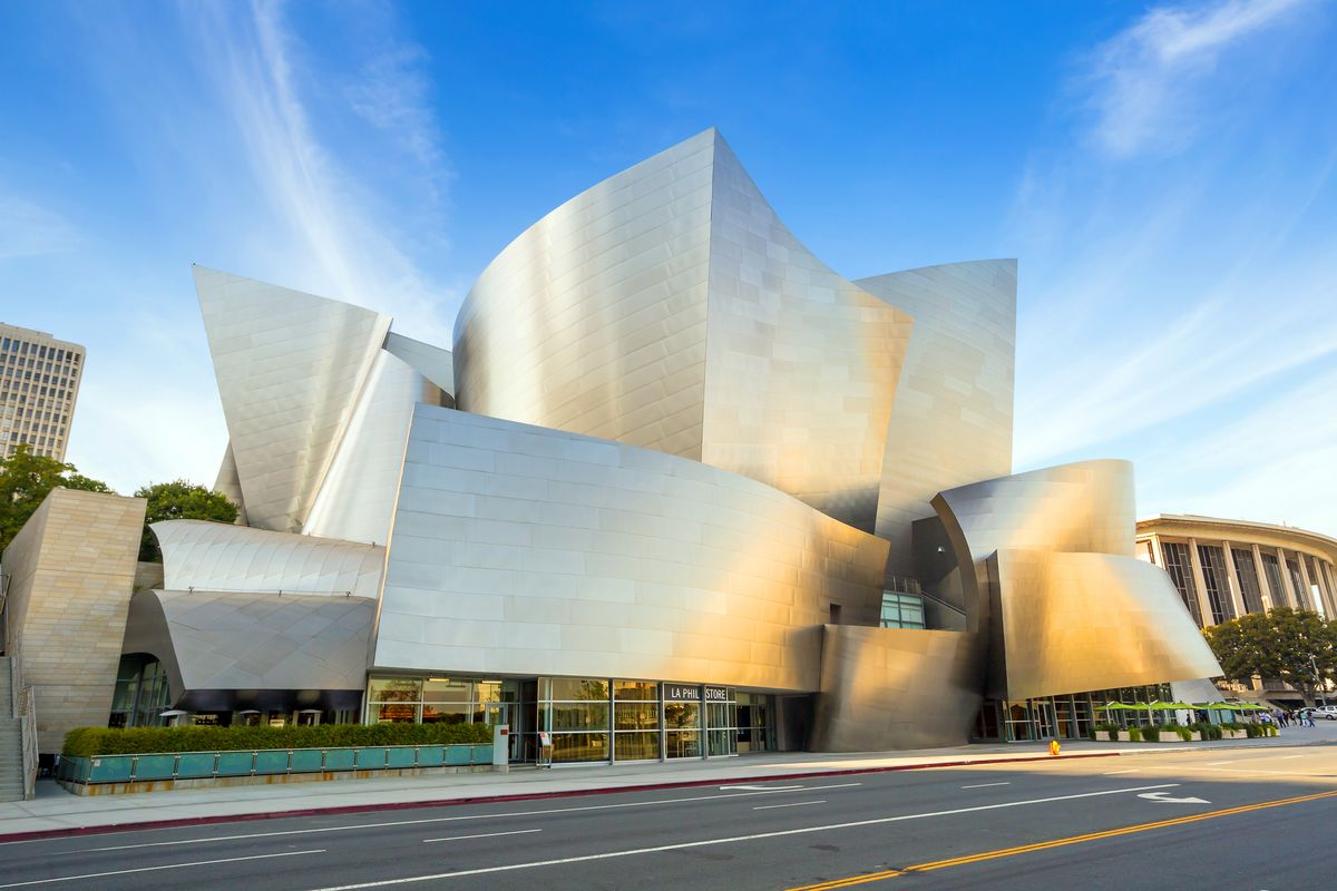 The exterior of the Walt Disney Concert Hall in Los Angeles. The walls and roof are stainless steel and curved.