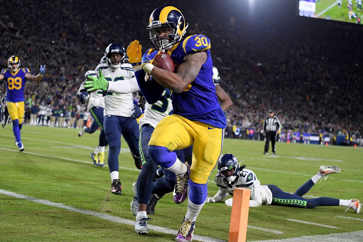 Running back Todd Gurley of the Los Angeles Rams rushes for a touchdown over the Seattle Seahawks in the fourth quarter of the game at Los Angeles Memorial Coliseum on December 08, 2019 in Los Angeles, California.