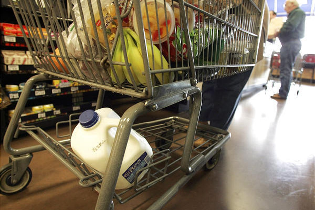 A cart full of a groceries is seen at the check-out counter at a Kroger store in Gahanna, Ohio, in March. Shoppers are increasingly ditching their items before they're rung up as they think twice about spending.