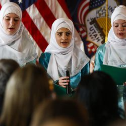 Members of the Bulbuli Children's Choir sing during a ceremony to celebrate the signing of a concurrent resolution affirming Utah's support for the religious and civil liberties of immigrants and refugees during a ceremony at the Capitol in Salt Lake City on Monday, April 17, 2017.