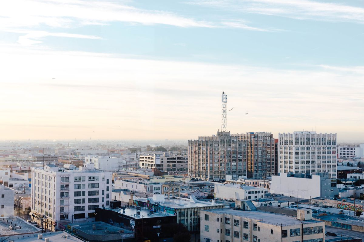 An early morning sky view of a portion of Downtown Los Angeles, with buildings under construction.