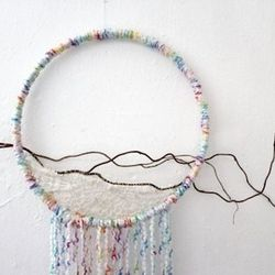 For the quiet poet, a place to hang all those dreams. Lace and Sticks Boho Decorative Wall Hanging, $45, The Big City Bumpkin
