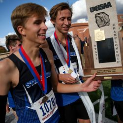 Stansbury's Talmage Ricks, Carson Belnap and Josh Oblad collect their team's first-place title in the 4A Boys State Cross-Country Championships at Highland High School in Salt Lake City on Wednesday, Oct. 23, 2019.