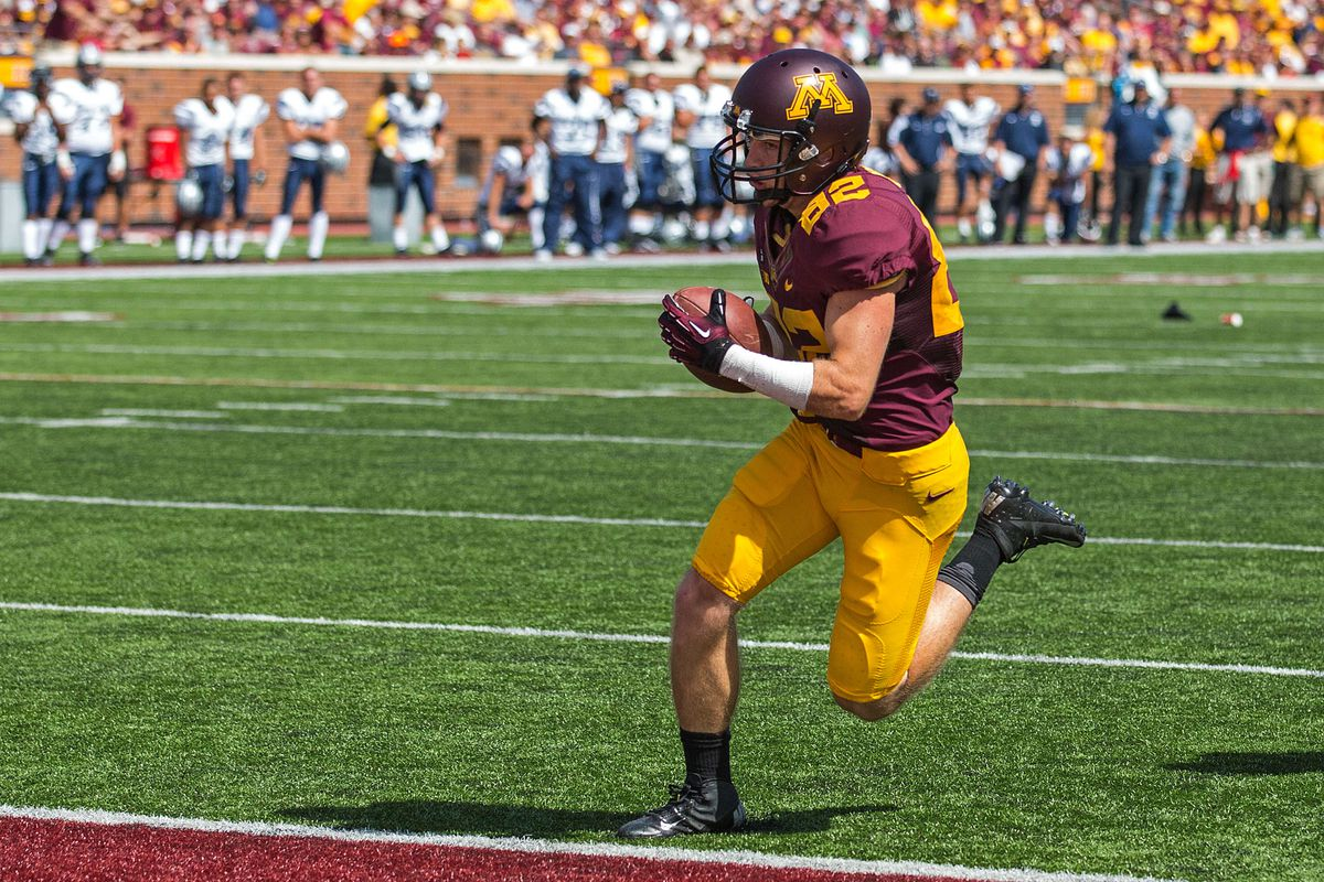 Sept 8, 2012; Minneapolis, MN, USA: Minnesota Gophers White Speed Receiver A.J. Barker (82) runs in for a touchdown against the New Hampshire Wildcats at TCF Bank Stadium. The Gophers won 44-7. Mandatory Credit: Jesse Johnson-US PRESSWIRE