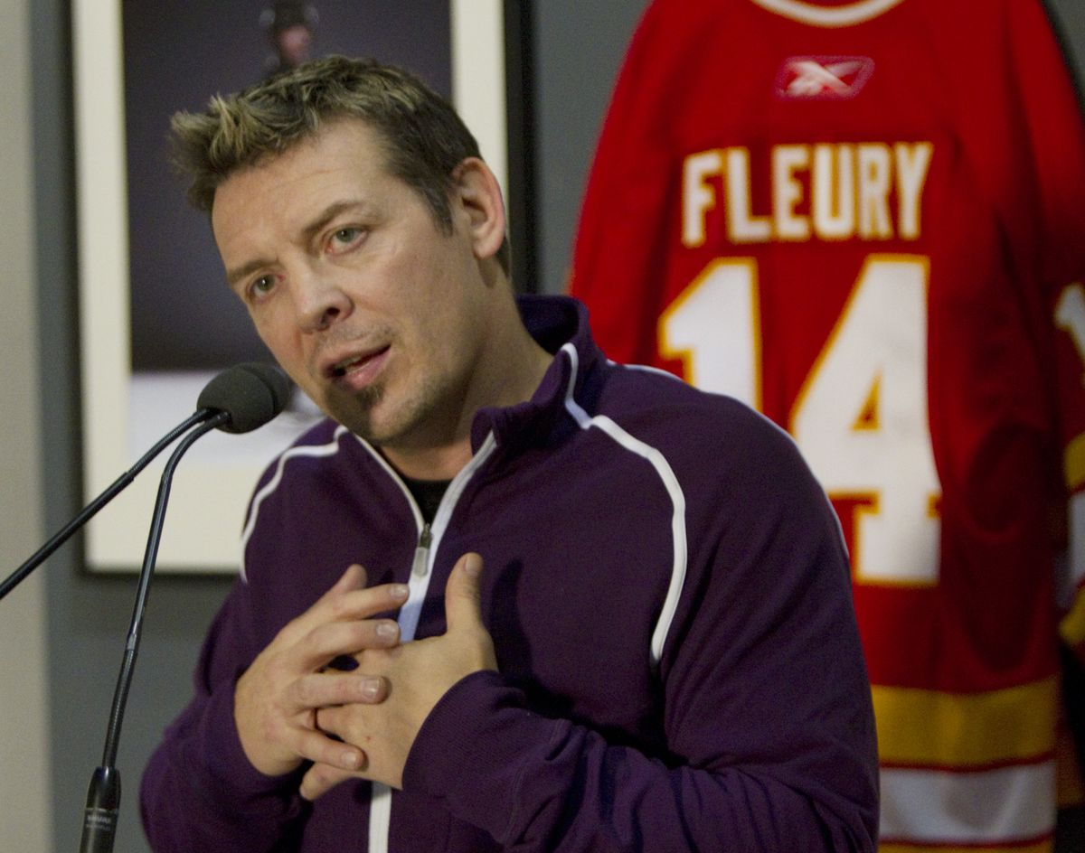 Theo Fleury talks to the medai today following the nationwide warrant issued for convicted sex offen