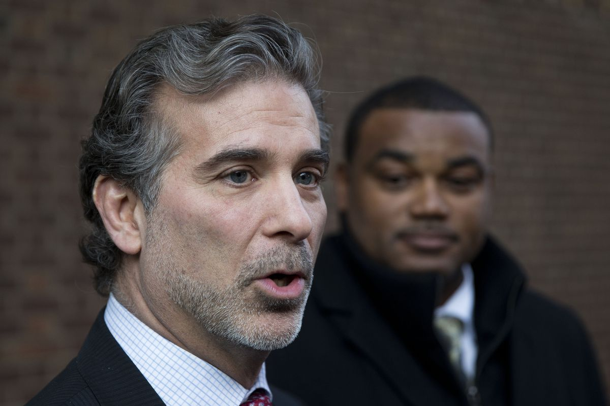 Lawyer Christopher Seeger, left, and his firm were granted $51 million in legal fees related to the NFL concussion case.