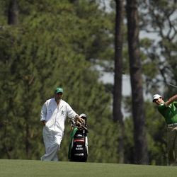 Rory McIlroy, of Northern Ireland, hits on the 15th fairway during a practice round at the Masters golf tournament Wednesday, April 4, 2012, in Augusta, Ga.