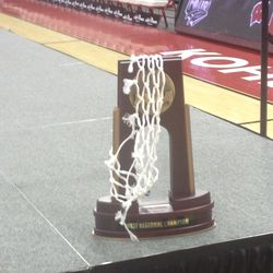 The West Regional Champion trophy adorned with a cut-down net from Anaheim.