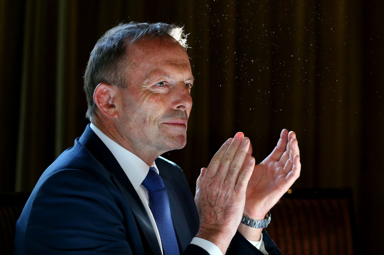 Tony Abbott clapping at a book launch