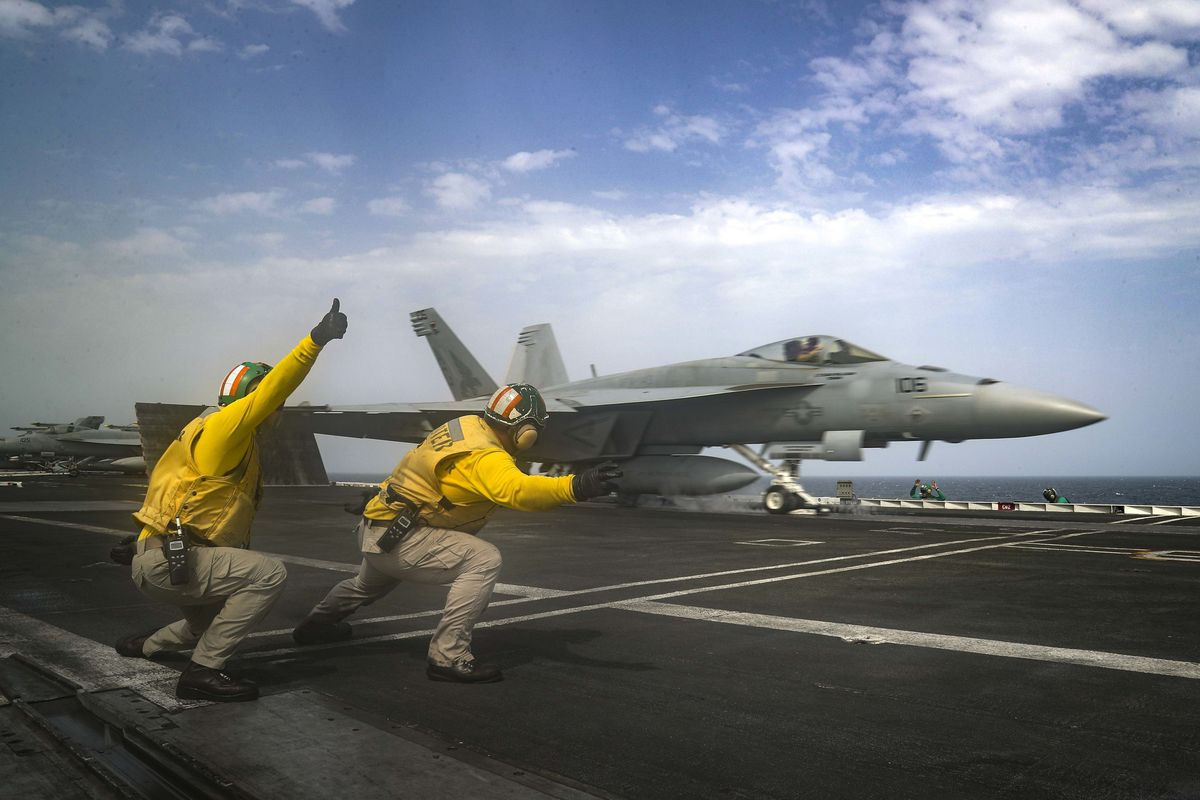 In this Thursday, May 16, 2019 photo released by the U.S. Navy, Lt. Nicholas Miller, from Spring, Texas, and Lt. Sean Ryan, from Gautier, Miss., launch an F-18 Super Hornet from the deck of the USS Abraham Lincoln aircraft carrier in the Arabian Sea. On S
