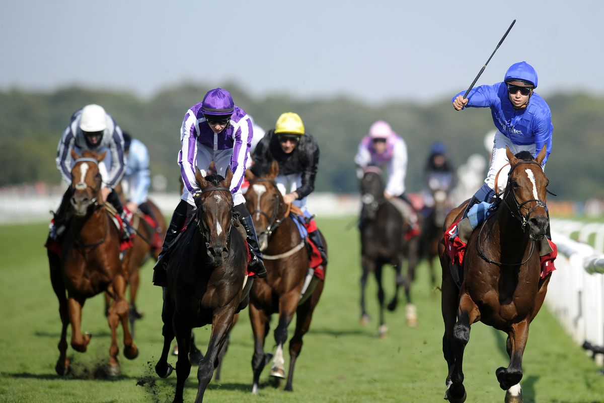 DONCASTER, ENGLAND - SEPTEMBER 15:  Mickael Barzalona riding Encke win The Ladbrokes St. Leger Stakes from Camelot (2L) at Doncaster racecourse on September 15, 2012 in Doncaster, England. (Photo by Alan Crowhurst/Getty Images)