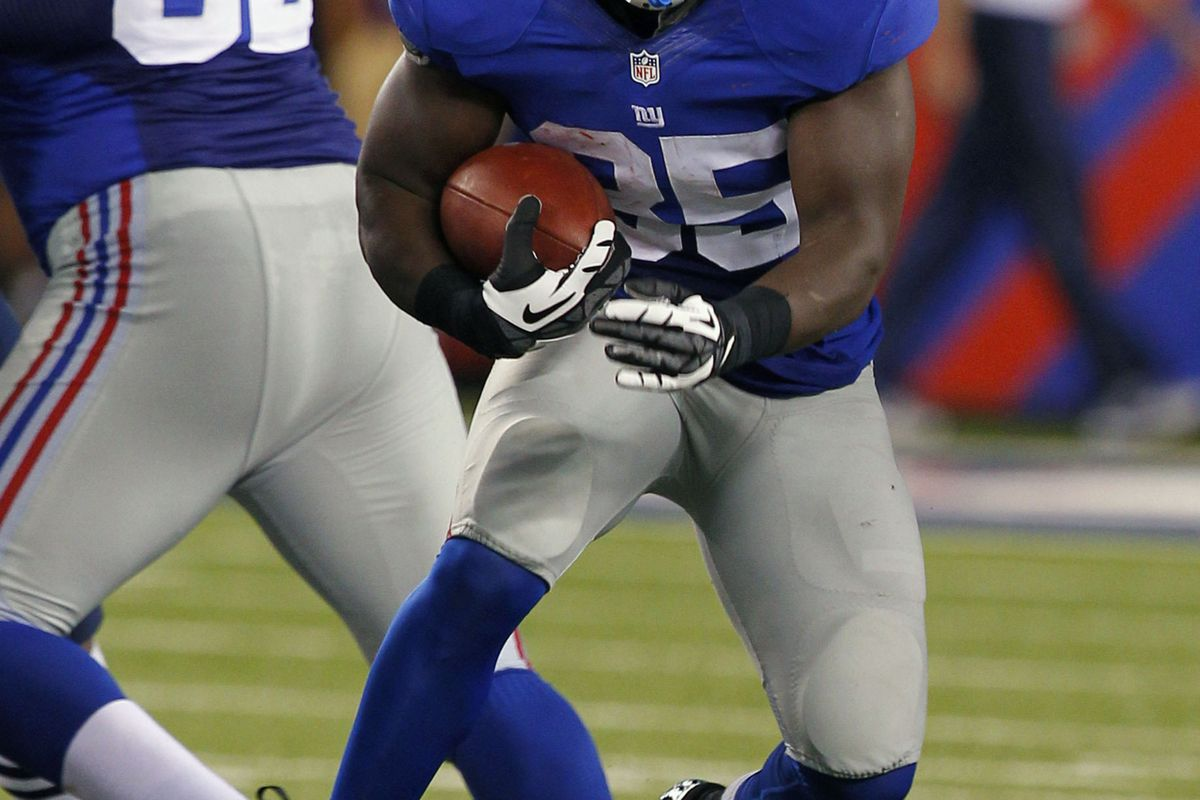 Aug 29, 2012; East Rutherford, NJ, USA;  New York Giants running back Andre Brown (35) finds opening against the New England Patriots during the second half at MetLife Stadium. Jim O'Connor-US PRESSWIRE