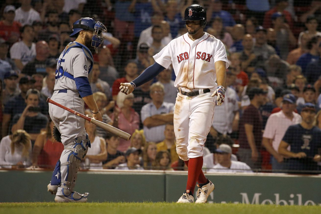 Boston Red Sox's Xander Bogaerts throws his bat after striking out with runners in scoring position in a tie game during the ninth inning of a baseball game against the Los Angeles Dodgers on July 14, 2019 in Boston, Massachusetts...
