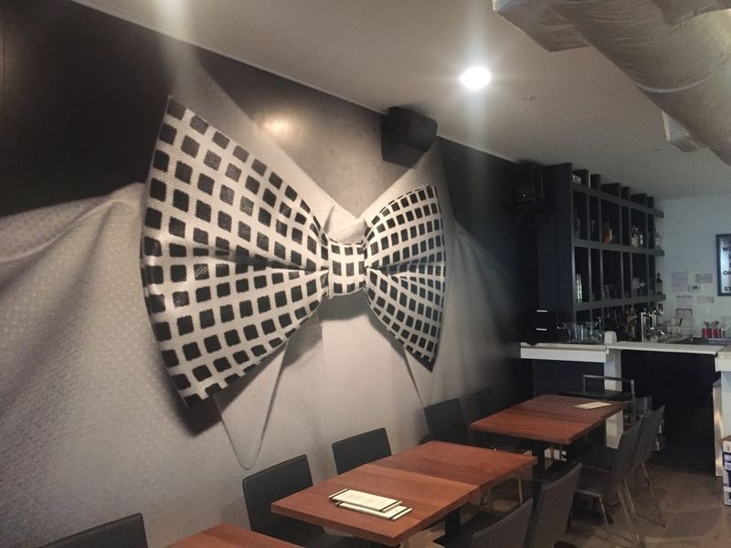 A bowtie mural inside the Dirty Goose on U Street NW