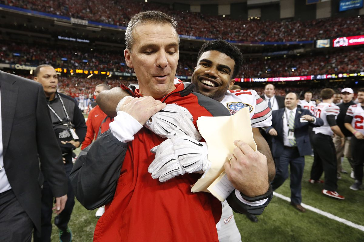 Ohio State coach Urban Meyer is hugged by Ezekiel Elliott following win over Alabama.