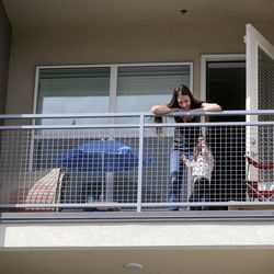 Whitney Beaslin and her daughter Charlotte play on the deck of their apartment in Sandy on Wednesday, April 1, 2020. Beaslin, a server and a single mom, is worried about getting evicted due to losing work from COVID-19 pandemic.