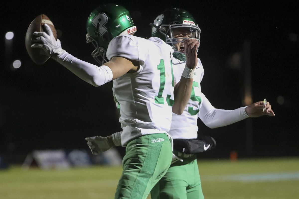 Provo wide receiver Ryder Macgillivray, left, and quarterback Luke Haslem celebrate a touchdown after Macgillivray made a diving catch in the end zone during game against Salem Hills in Salem on Friday, Oct. 4, 2019.