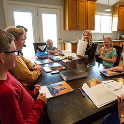"""The Kirby family gathers for a gospel study at home using """"Come, Follow Me — For Individuals and Families: Book of Mormon 2020"""", a manual for The Church of Jesus Christ of Latter-day Saints, in Lehi on Sunday, March 15, 2020."""