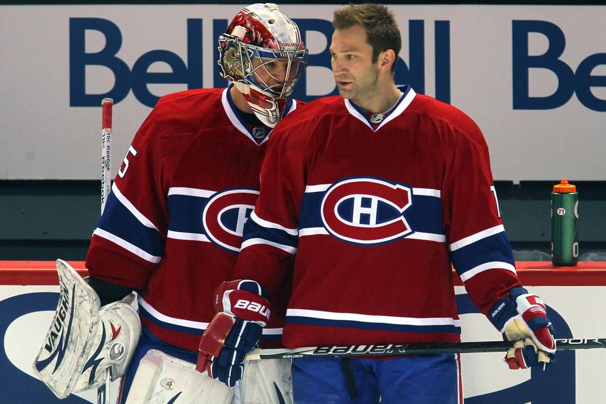 Apr 07, 2012; Montreal, QC, CAN; Montreal Canadiens goalie Robert Mayer (65) and left wing Erik Cole (72) before the first period against Toronto Maple Leafs at the Bell Center. Mandatory Credit: Jean-Yves Ahern-US PRESSWIRE
