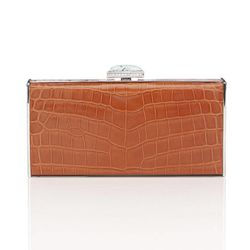 This product image courtesy of Judith Leiber shows a Judith Leiber Jelly Bean Collection clutch. Pantone has chosen a reddish-orange hue as their top color of the year for 2012.