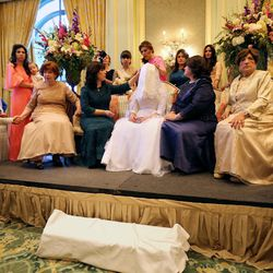 Jettie Schochet, Sharonne Zippel, Chaya Zippel, Rosa Cohen and Suzanne Cohen sit after the badeken, or veiling ceremony, before Chaya marries Rabbi Mendy Cohen in a traditional Chabad Lubavitch Jewish ceremony at the Grand America Hotel in Salt Lake City on Monday, Sept. 12, 2016.