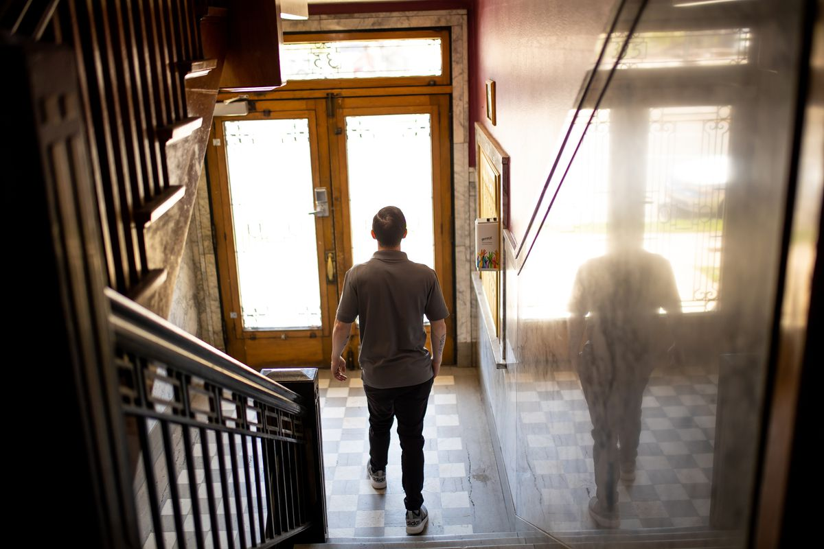 Jesse Goertzen walks through one of the apartment buildings owned by The Other Side Academy, where he lives, while posing for photos in Salt Lake City on Thursday, April 29, 2021. The nonprofit organization has been tapped by the city to operate a planned tiny home community to house homeless people.