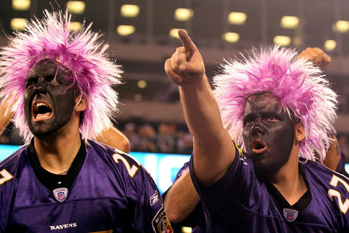 EAST RUTHERFORD NJ - SEPTEMBER 13:  Fans of the Baltimore Ravens cheer during the game against the New York Jets at the New Meadowlands Stadium on September 13 2010 in East Rutherford New Jersey.  (Photo by Jim McIsaac/Getty Images)