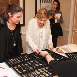 Maria Kivi (pictured right with her sister) was offered a trunk show for her jewelry, which combines new and vintage pieces.