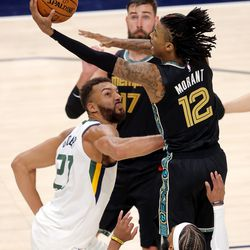 Memphis Grizzlies guard Ja Morant (12) goes up for a shot as the Utah Jazz and the Memphis Grizzlies play in game one of their NBA playoff series at Vivint Arena in Salt Lake City on Sunday, May 23, 2021. Memphis won 112-109.